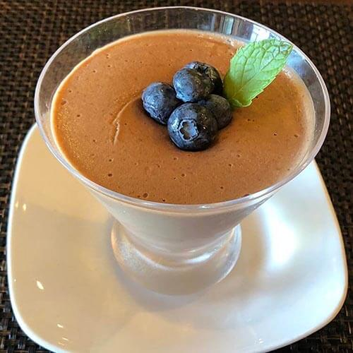 millet chocolate pudding with blackberry and mint